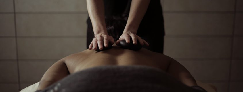 person getting massage at the spa