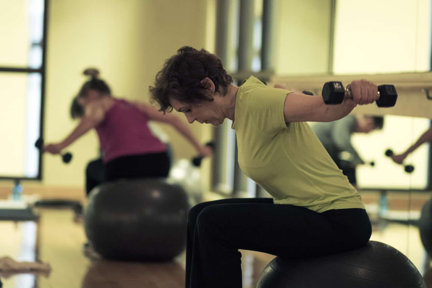 Woman concentrating during group fitness class.