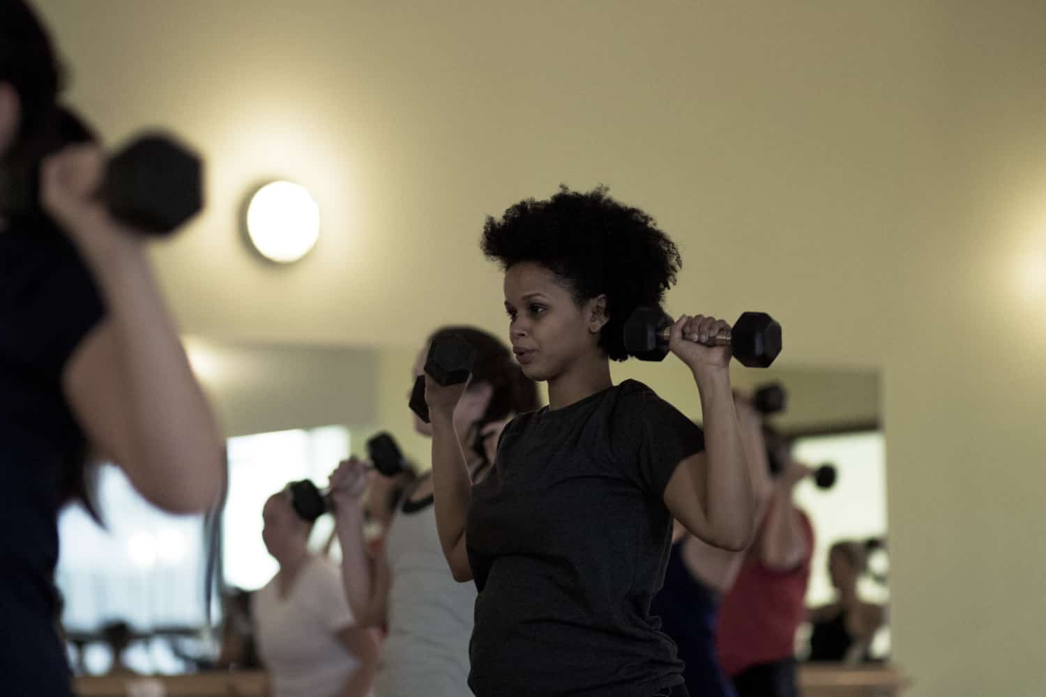 Woman working out during at group fitness class at FFC.