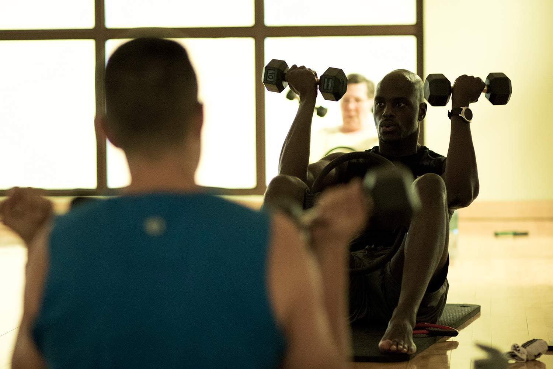 Men taking a Modern Mat group fitness class at FFC.