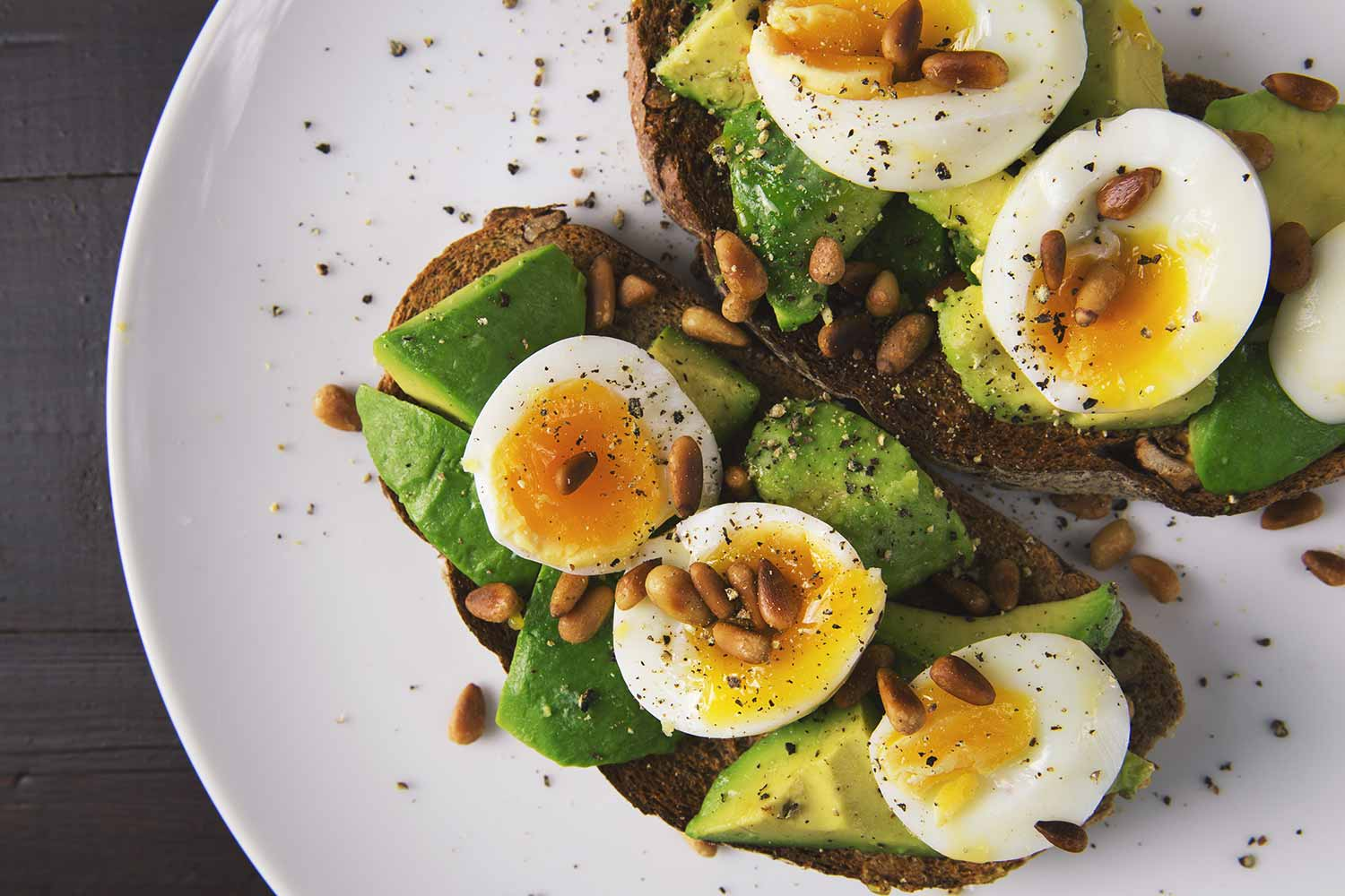 Healthy meal of eggs and avocado on toast.