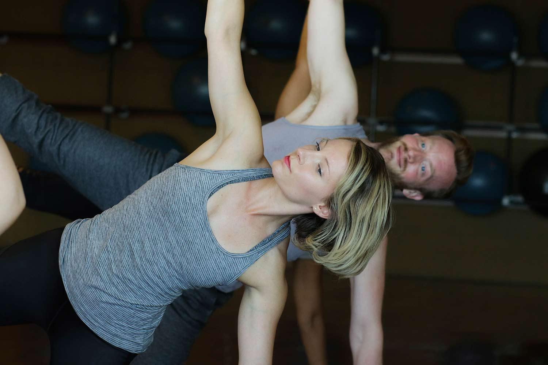 Man and woman doing yoga.