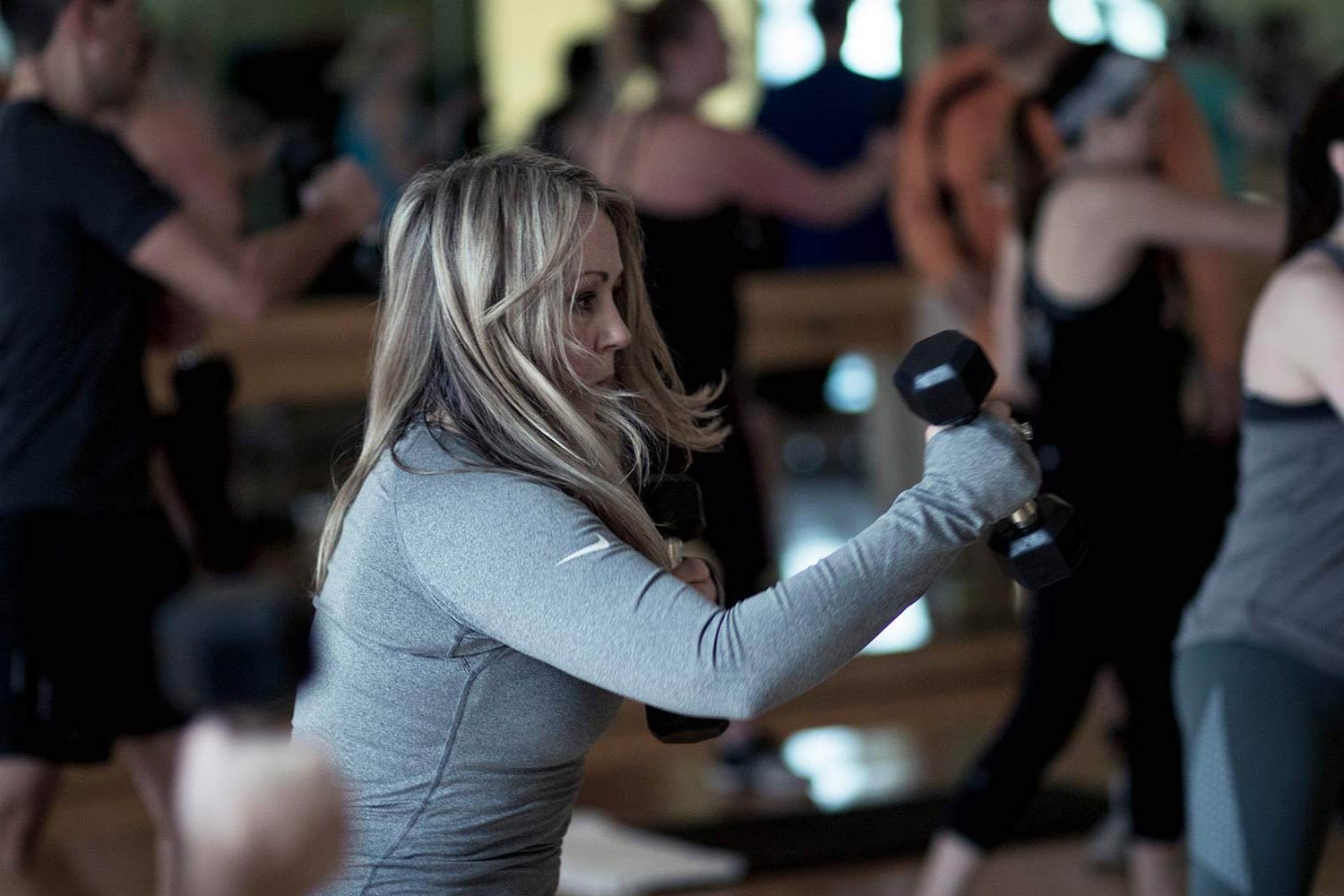 Woman taking a signature group fitness class at FFC.