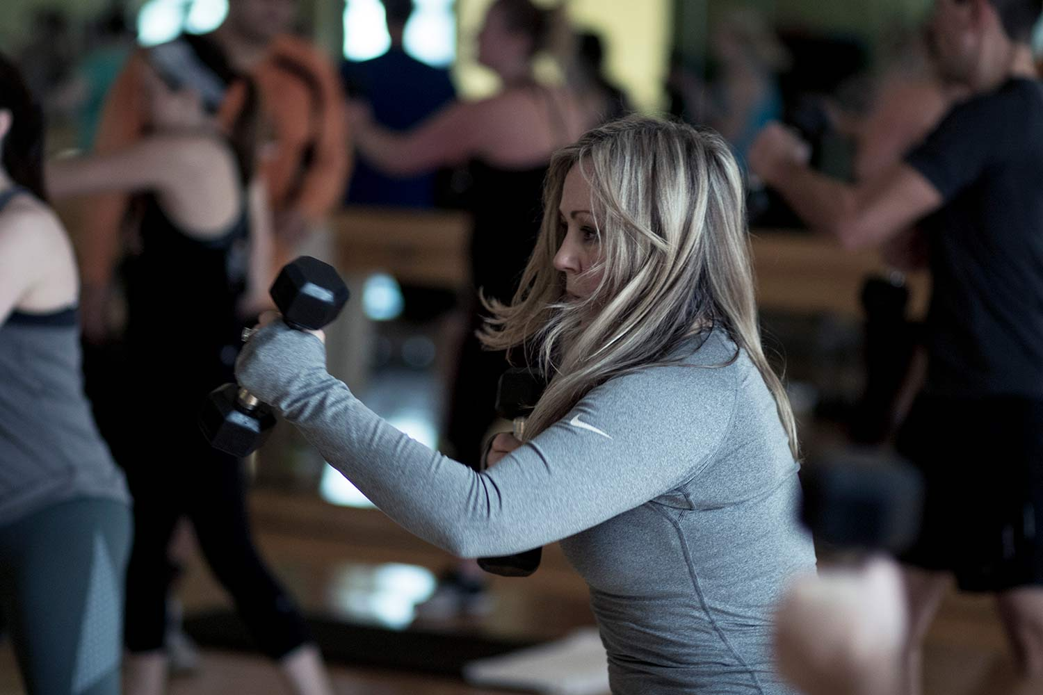 Female taking a group fitness signature class.