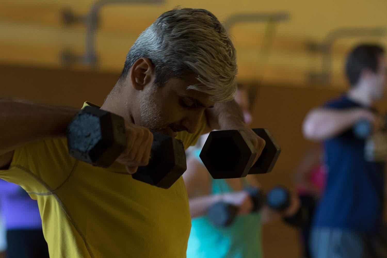 Man lifting free weights.