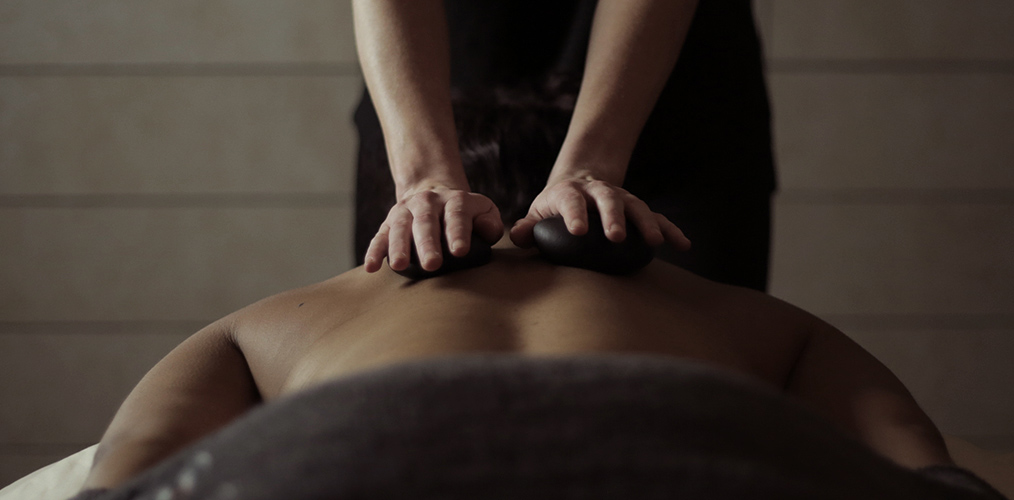 Club member getting a hot stone massage.