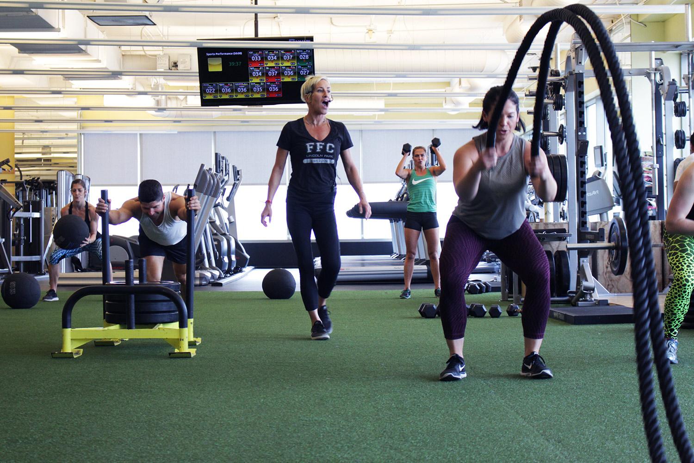 Coach motivating a performance training class.