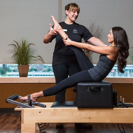 Woman in a pilates lesson.