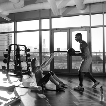 A couple working out together in the gym.