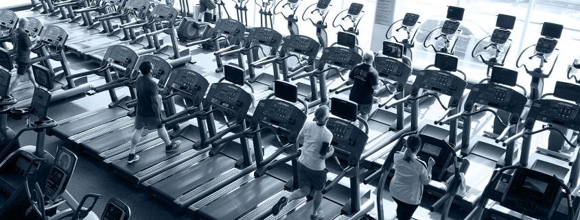 Men and women running on treadmills at FFC Park Ridge.