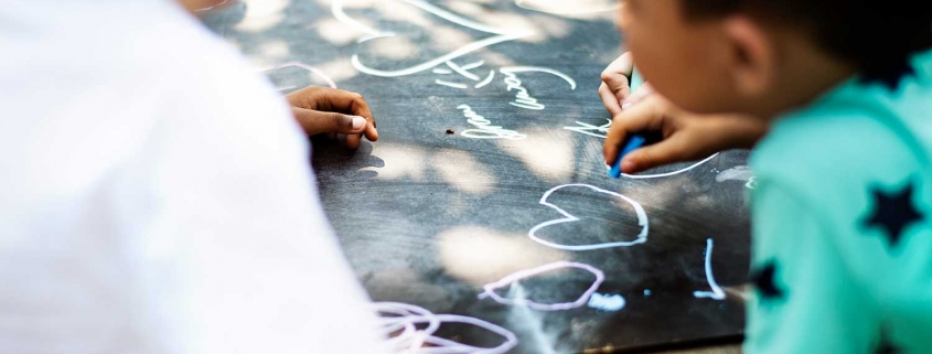 Kids drawing with chalk