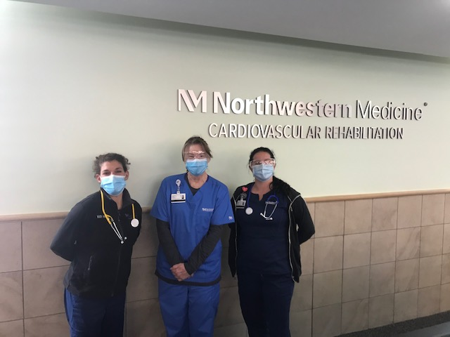 Northwestern Medicine staff posing in front of their logo at FFC Gold Coast