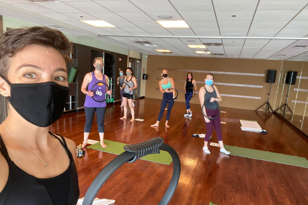 Group of women wearing face masks in a group fitness class