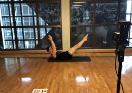 Photo of David Bohn doing Pilates.