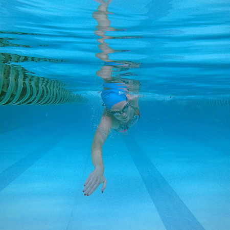 Woman swimming in a lap pool.