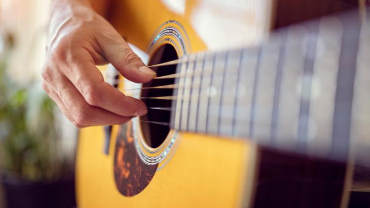 Closeup Photo of Acoustic Guitar
