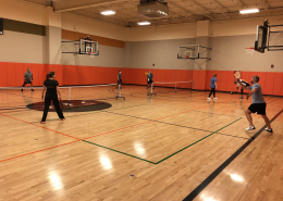 Image of a group of people playing pickleball