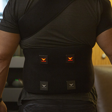 Photo of man wearing the Venom heat recovery device