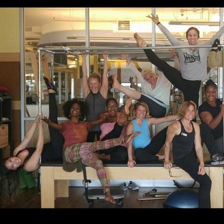 Group of wmoen on a Pilates reformer
