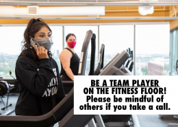 Woman talking on cell phone in the gym on a treadmill.
